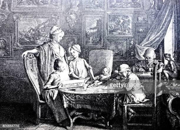 Famille assis dans le salon, autour d'une table, jouer et parler