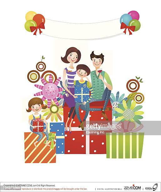 Family sitting on gifts