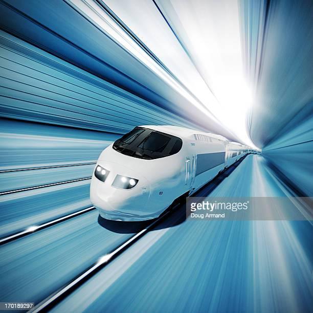 a fast modern train speeding through a tunnel - transportation stock illustrations