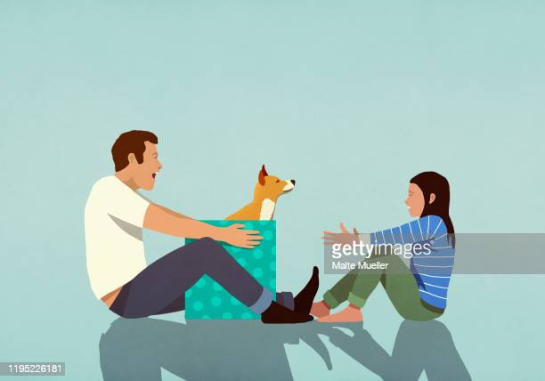 father surprising daughter with puppy gift - family stock illustrations