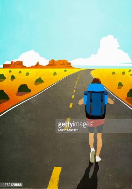 female backpacker walking on remote, arid desert road - 乾燥気候点のイラスト素材/クリップアート素材/マンガ素材/アイコン素材