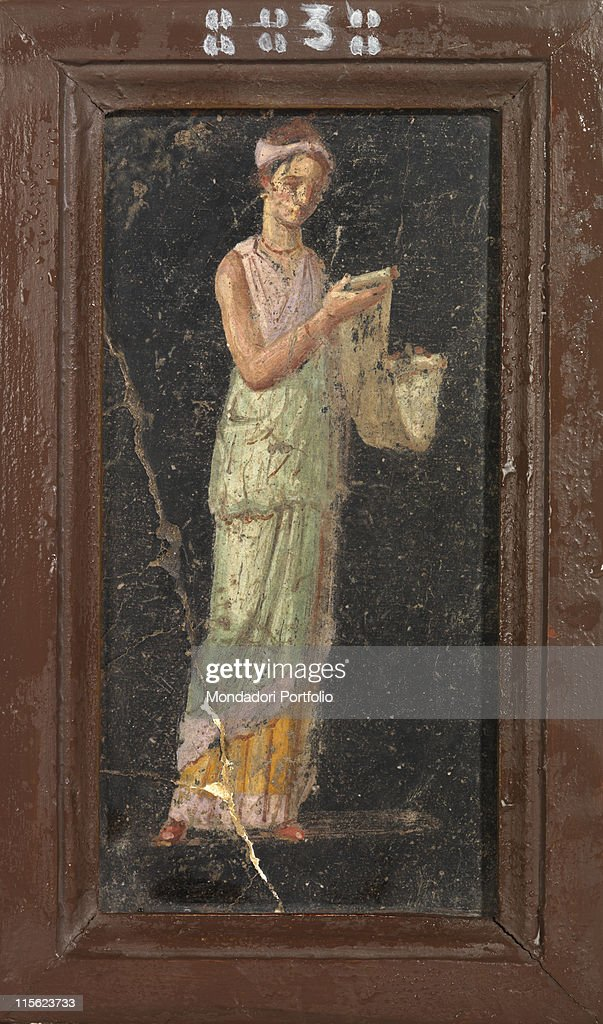 Female figure with papyrus, by Unknown, 1st Century b.C.- 1st Century, painted stucco : News Photo