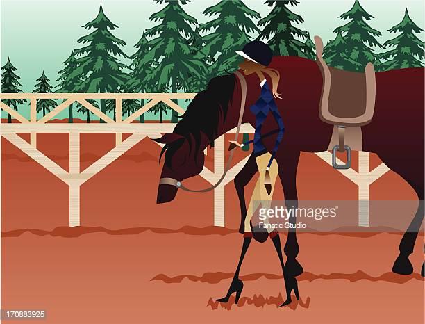 Female jockey walking with a horse