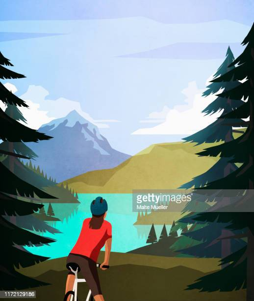 female mountain biker looking at idyllic, tranquil mountain lake view - journey stock illustrations