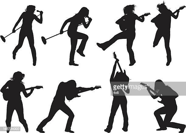 female rock star - standing on one leg stock illustrations, clip art, cartoons, & icons
