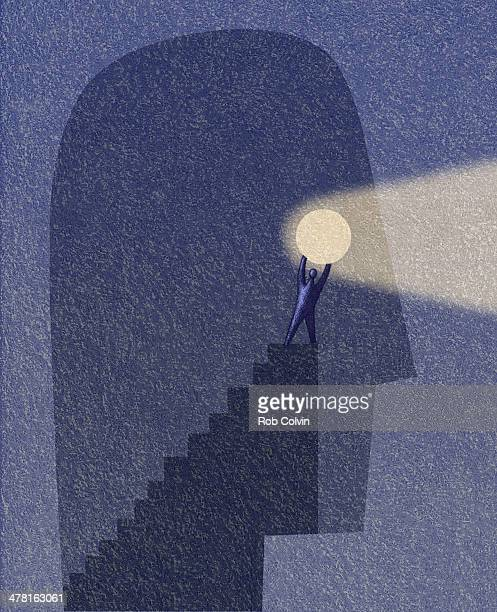 Figure holding bright light on staircase