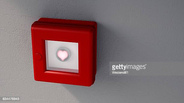 Fire alarm with shining heart on grey wall