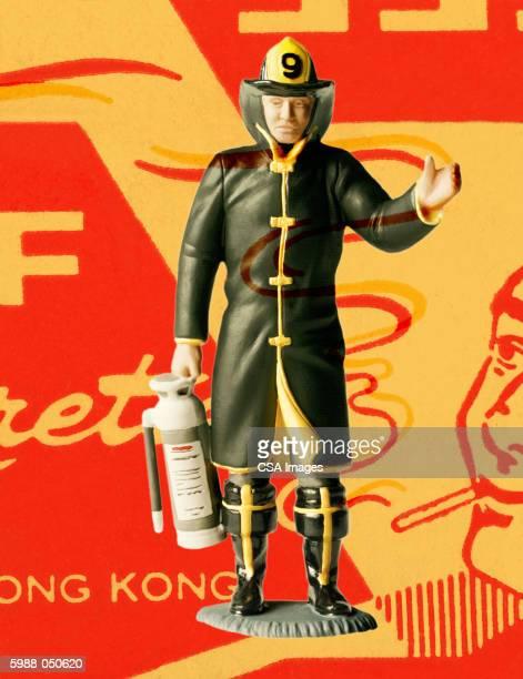 fireman figurine - figurine stock illustrations, clip art, cartoons, & icons