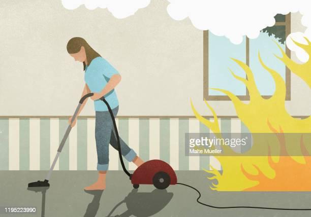flames and smoke behind oblivious woman vacuuming carpet - {{ contactusnotification.cta }} stock illustrations