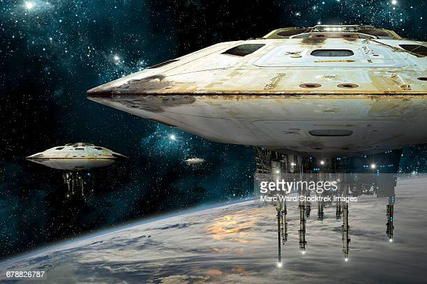 A fleet of massive spaceships known as motherships take position over Earth for a coming invasion.