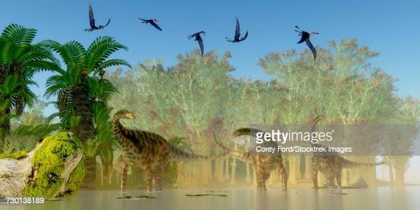 A flock of Dorygnathus fly over a herd of Spinophorosaurus dinosaurs.