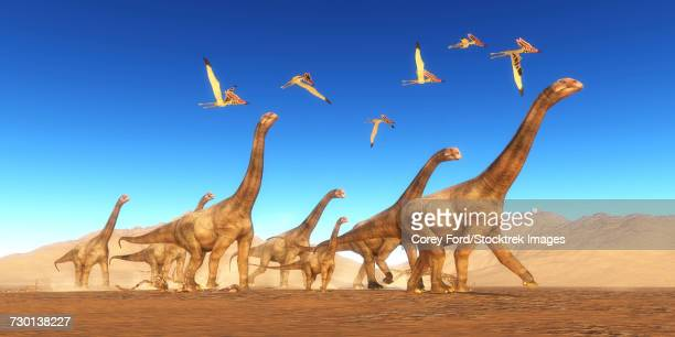 A flock of Thalassodromeus reptiles fly over a herd of Brontomerus dinosaurs.