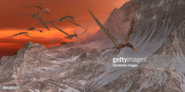 A flock of Zhenyuanopterus flying past the mountainside.