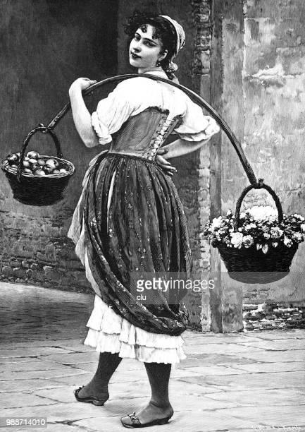 Florist carries two flower baskets over the shoulder