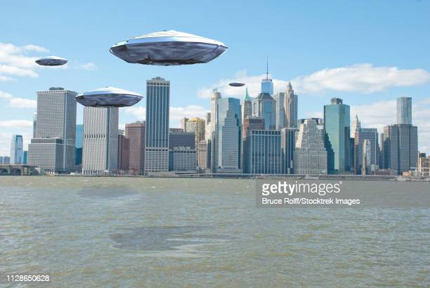Flying saucers over New York harbor. 3D Rendering