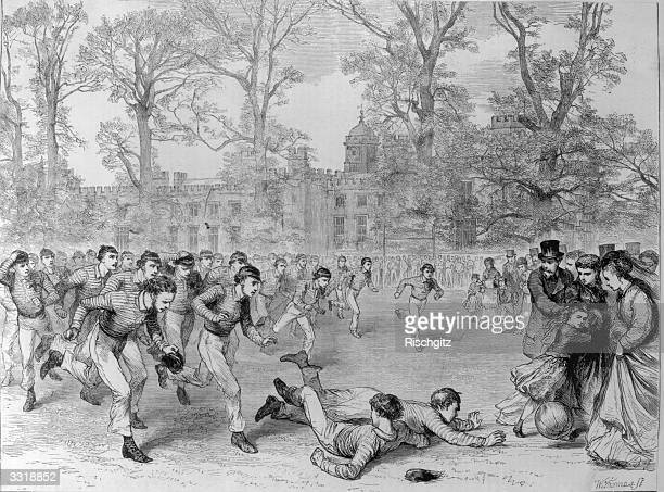 Football as played at Rugby school The ball is round but the goal posts are more reminiscent of rugby Original Publication The Graphic pub 1870...