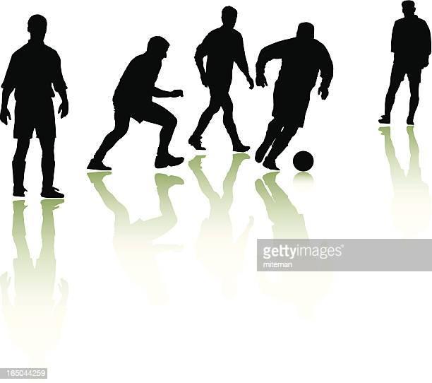 Silhouetten der Fußballer