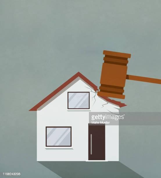 foreclosure gavel pounding on house - subprime loan crisis stock illustrations