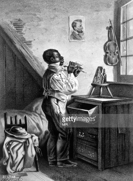 A freed slave getting dressed a picture of President Lincoln hangs on his wall Printed by Currier Ives