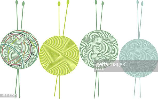 Four balls of yarn and knitting needles