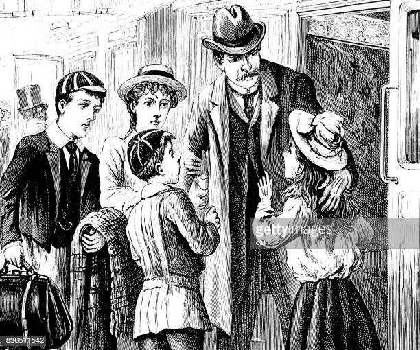 Vier kinderen verwelkomen een man bij de station