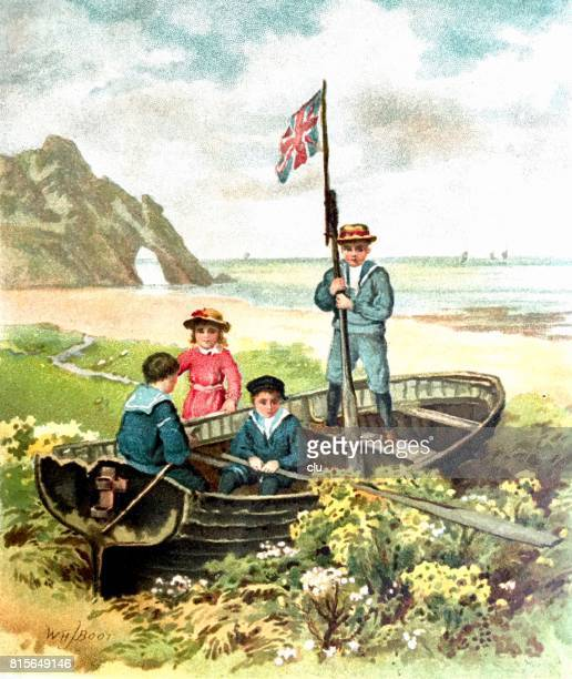 Four kids in boat with english flag parked at the beach