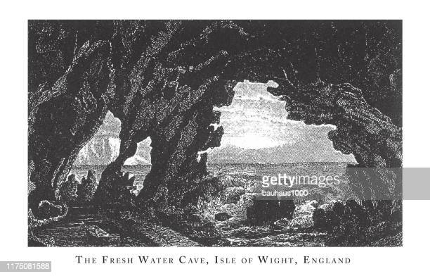 fresh water cave, isle of wight, england, forests, lakes, caves and unusual rock formation engraving antique illustration, published 1851 - natural arch stock illustrations, clip art, cartoons, & icons