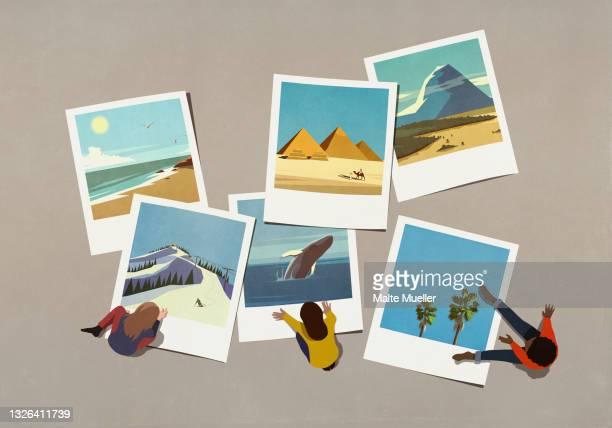 friends enjoying travel photos - nostalgia stock illustrations