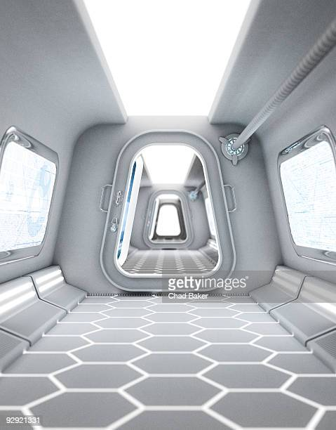 A futuristic hallway leading to a bright doorway