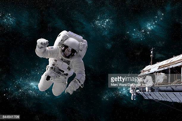 A galactic scene showing astronauts working on space station.