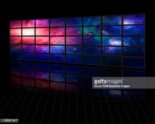 galaxies and stars on screens in dark space. - wide screen stock illustrations