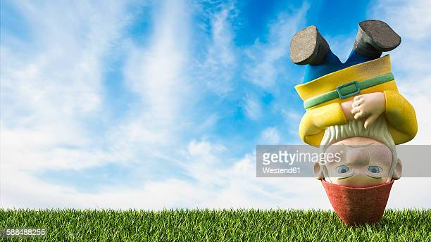 garden gnome head first on a meadow, 3d rendering - gnome stock illustrations
