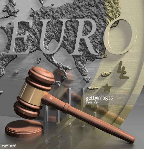 Gavel in front of euro coin