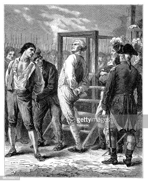 georges jacques danton (1759 - 1794) (center) as he defiantly looks over the crowd as he climbs the steps to his execution by guillotine for conspiracy to overthrow the government during the french revolution, paris, france, april 5, 1794 - execution stock illustrations