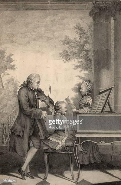 German composer Leopold Mozart playing the violin accompanied by his seven year old son Wolfgang Amadeus Mozart on the harpsichord while his daughter...
