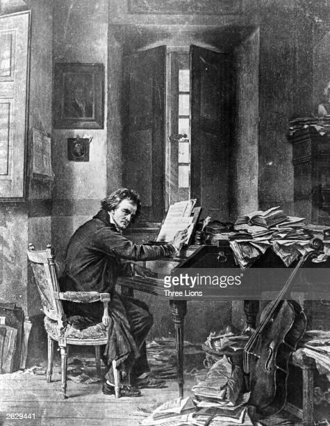 German composer Ludwig van Beethoven composing at a a piano, circa 1800.