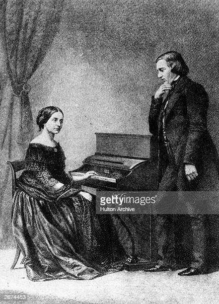 German composers Robert Alexander Schumann and wife Clara Schumann who is playing the piano. Original Artwork: An engraving from a daguerreotype .