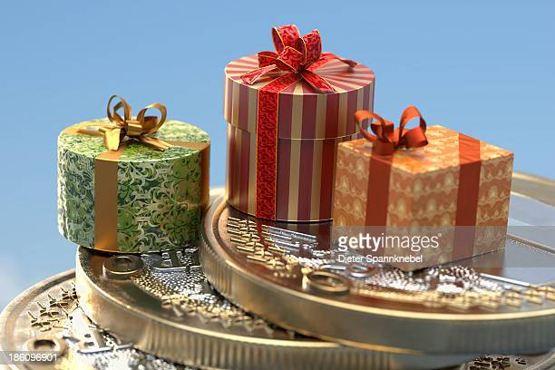 gift boxes on a stack of euro coins - christmas cash stock illustrations