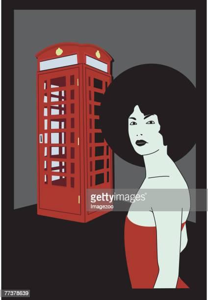 girl at a british phone booth