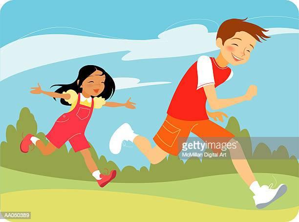 Girl chasing boy in park
