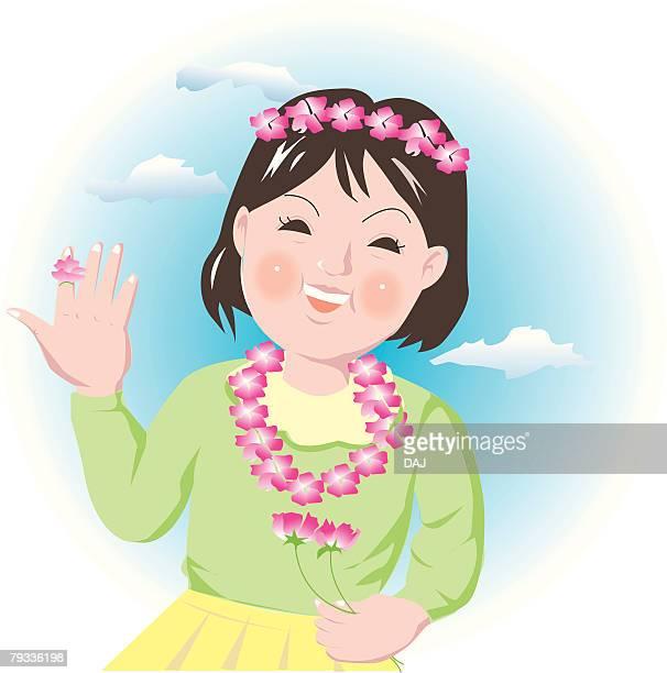 Girl enjoying flower arrangement, smiling