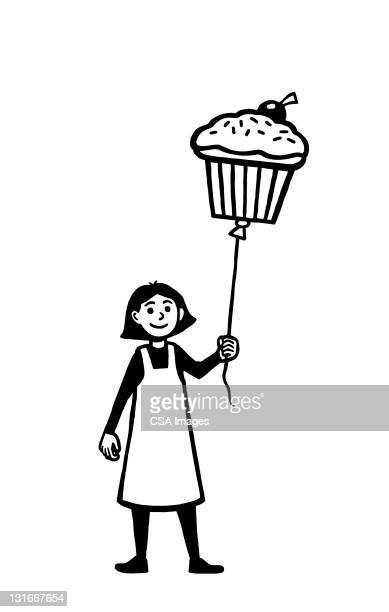 girl holding cupcake on string - cake stock illustrations