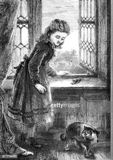 Girl in room standing at the window talking to her cat having just killed a bird