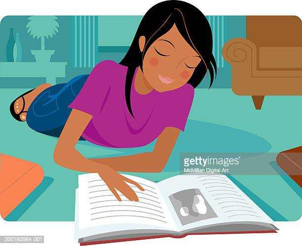 Girl lying on floor, reading book