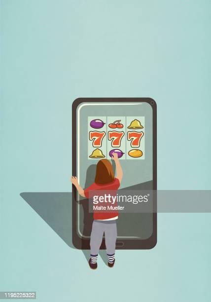 girl playing slot machine game on large smart phone - gambling addiction stock illustrations