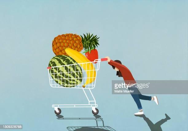 girl pushing shopping cart full of fresh fruit - full length stock illustrations