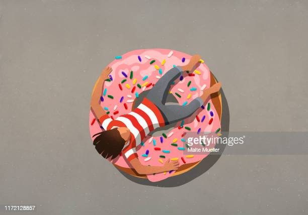 girl relaxing on large donut with sprinkles - unhealthy eating stock illustrations