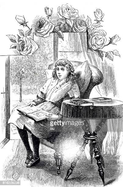 Girl sitting in living room holding the picture book