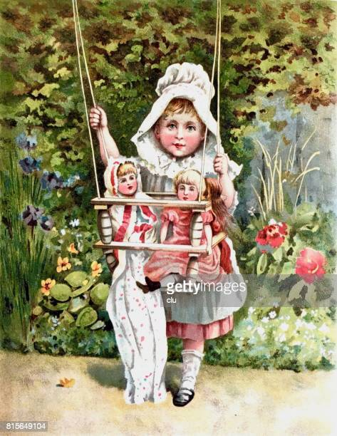 Girl standing in garden holding a swing with two puppets