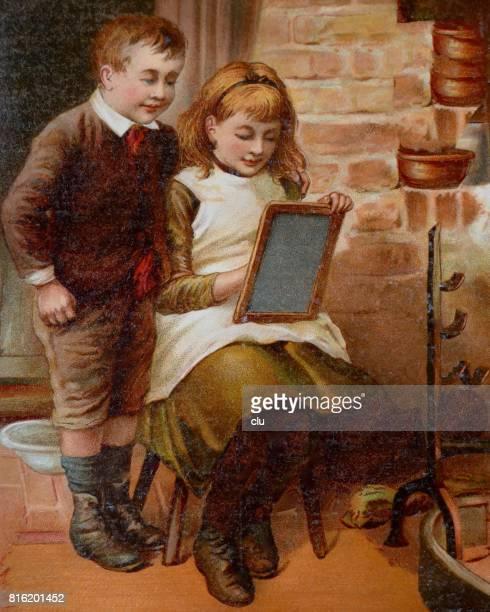 Girl writing on slite, boy standing aside looking